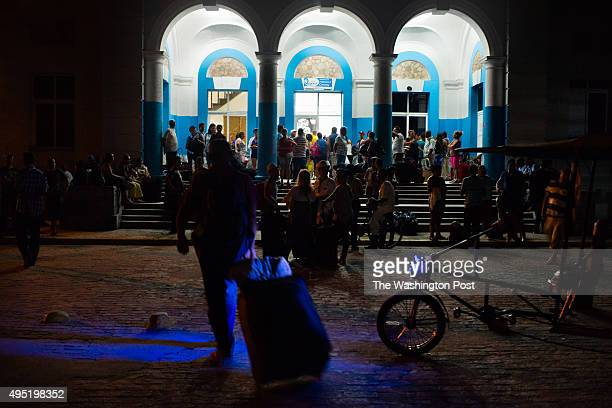 Nueva Gerona is the capital of Isla de la Juventud Before sunrise on August 12 2015 travelers fill up the ferry terminal on the banks of the river...