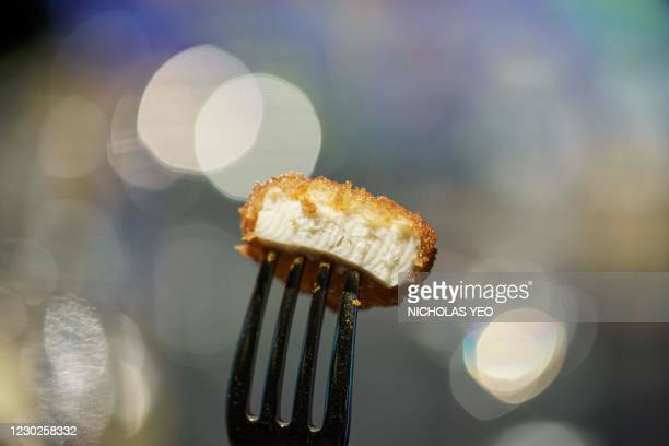 Nugget made from lab-grown chicken meat is seen during a media presentation in Singapore, the first country to allow the sale of meat created without...