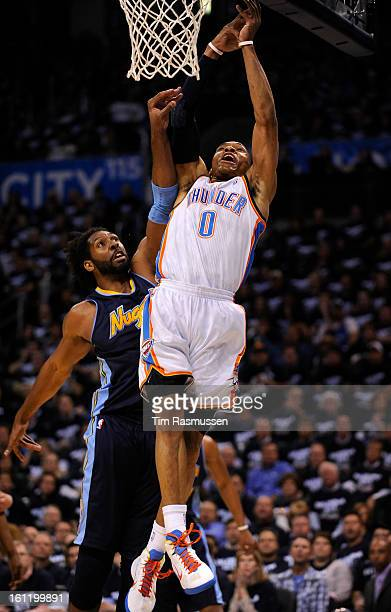 Nuggets center Nene Hilario fouls Thunder point guard Russell Westbrook during the first quarter of Game 5 of the NBA Playoffs first round between...