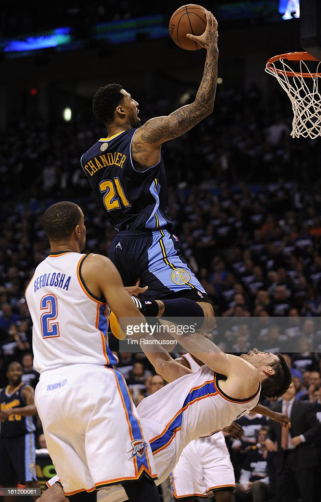 Nuggets small forward Wilson Chandler (21) takes the ball in for 2 as Thunder power forward Nick Collison (4) is called for the block during the fourth quarter. Game 5 of the NBA Playoffs first round between Denver Nuggets and Oklahoma City Thunder, April : News Photo