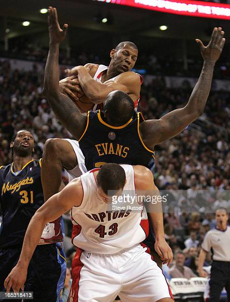 NUGGETS03/23/07Joey Graham comes down with a rebound against Reggie Evans ontop of Kris Humphries as the Toronto Raptors host the Denver Nuggets at...