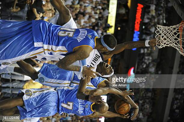 nuggetsMaverick11 The Denver Nuggets JR Smith and Chauncey Billups go for the ball after Carmelo Anthony fouls Josh Howard late in the 4th period vs...