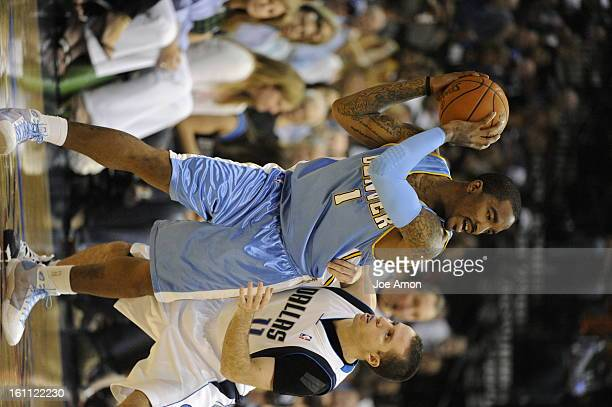 nuggetsMaverick11 The Denver Nuggets JR Smith holds off Jose Juan Barea in the 3rd period vs the Dallas Mavericks at American Airlines Center in...