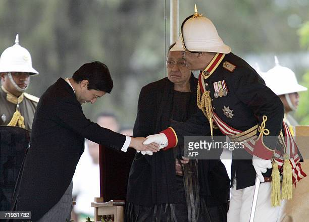 Nuku'alofa TONGA Tonga's new King King George Tupou V shakes hands with the Japan's Crown Prince Naruhito as Queen Halaevalu Mata'aho watches after...