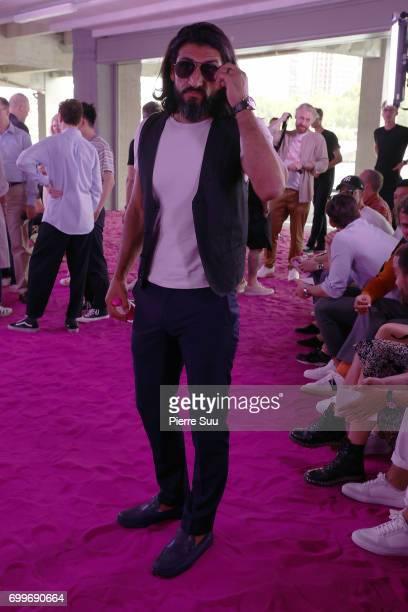 Numan Acar attends the Ami show during the Paris Fashion Week Menswear Spring/Summer 2018 on June 22 2017 in Paris France
