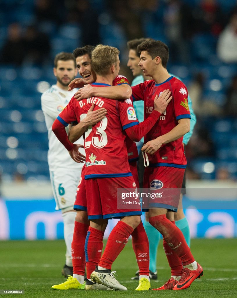 Numancia players celebrate after drawing 2-2 against Real Madrid in the Copa del Rey, round of 16, second leg match between between Real Madrid and Numancia at estadio Santiago Bernabeu on January 10, 2018 in Madrid, Spain.
