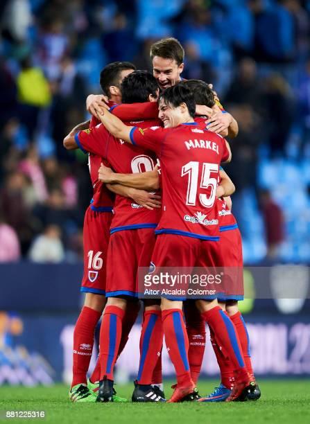 Numancia players celebrate after eliminating Malaga CF at the end of the Copa del Rey match between Malaga CF and Numancia at La Rosaleda Stadium on...