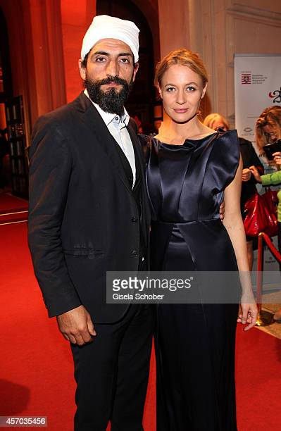 Numar Acar and his girlfriend Julia Thurnau attend the Hessian Film And Cinema Award 2014 on October 10 2014 at Alte Oper in Frankfurt am Main Germany
