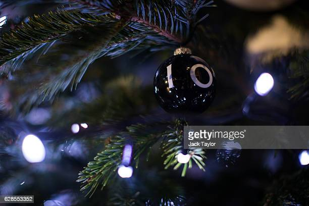 Number 10 bauble hangs on the Christmas tree outside Number 10, Downing Street after being switched on by British Prime Minister Theresa May on...