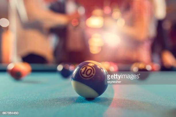 Number 10 billiard ball on the pool table.