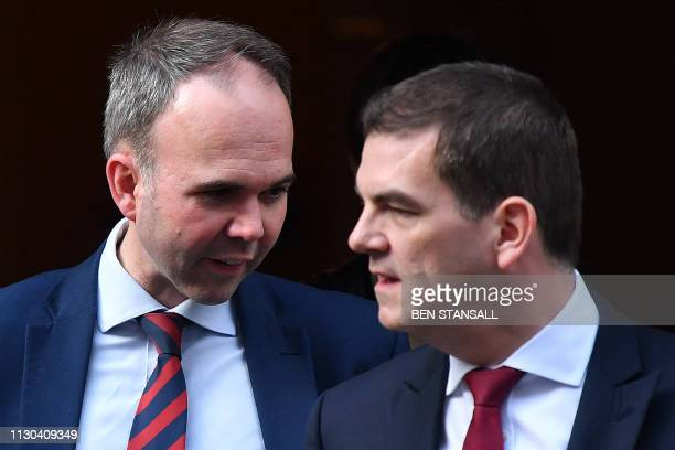 Number 10 Chief of Staff Gavin Barwell and Oliver 'Olly' Robbins the Prime Minister Theresa May's Europe Adviser leave from 10 Downing Street in...