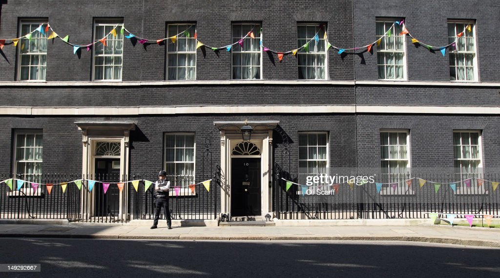 Number 10 Downing Street is bedecked in bunting to celebrate the London 2012 Olympic Games on July 26, 2012 in London, England. The Olympic flame is making its way through the capital on penultimate day of its journey around the UK before arriving in the Olympic Stadium on Friday evening for the Olympic games Opening Ceremony.