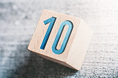 Number 10 On A Wooden Block On A Table