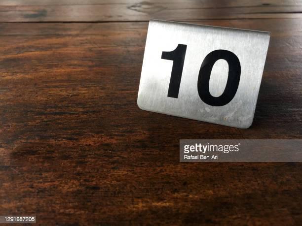 number 10 sign on a wooden table - rafael ben ari fotografías e imágenes de stock
