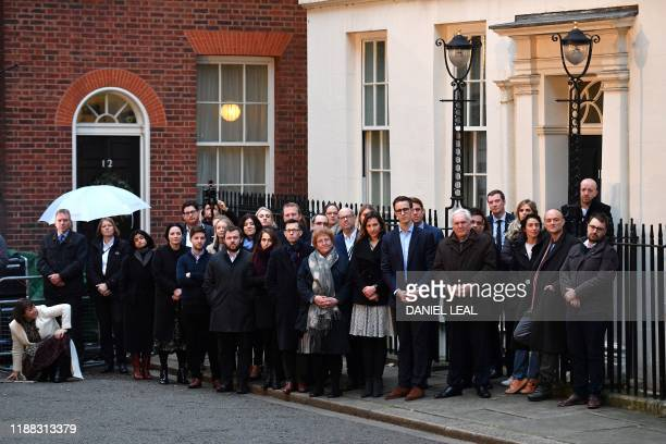 Number 10 special advisor Dominic Cummings and other members of Britain's Prime Minister Boris Johnson's staff listen as he delivers a speech outside...