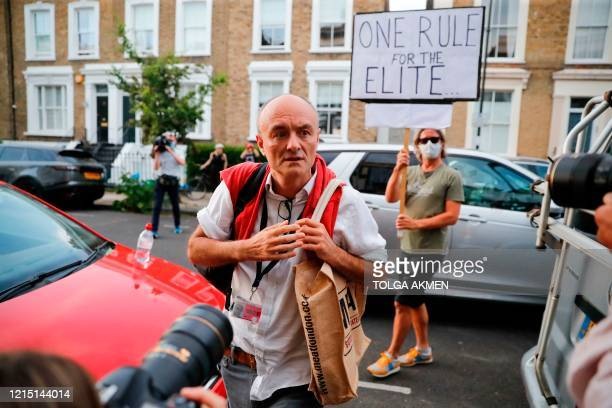 TOPSHOT Number 10 special advisor Dominic Cummings arrives home in London on May 25 after giving a press conference answering allegations he and his...