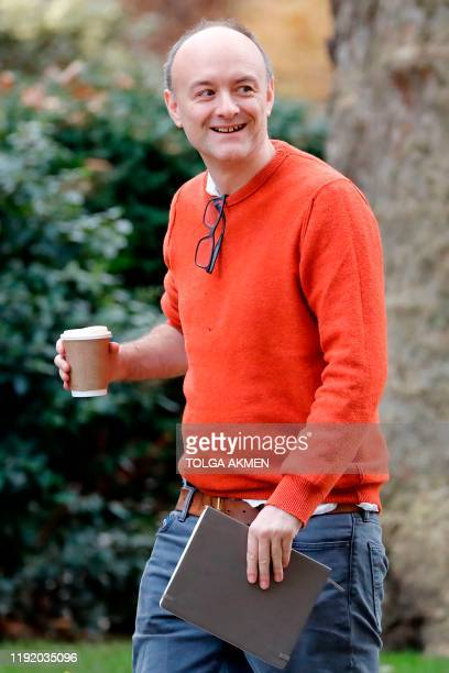 Number 10 special advisor Dominic Cummings carries a cup as he walks back to 10 Downing Street in central London on January 6 2020