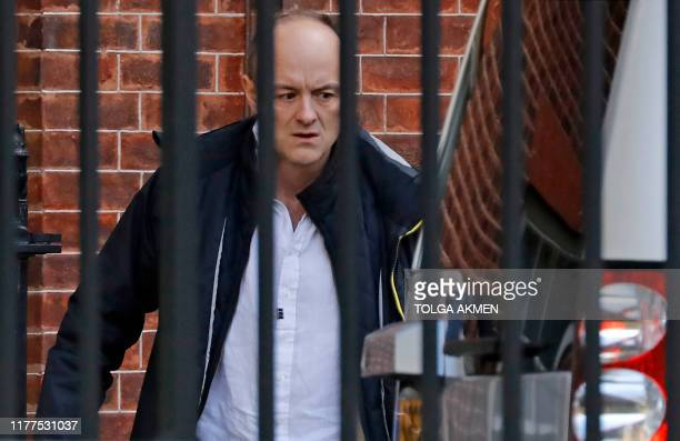 Number 10 special advisor Dominic Cummings walks to a waiting car as he leaves from the rear of 10 Downing Street in central London on October 22...