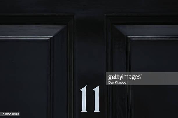Number 11 is displayed on the door of the official residence of Britain's Second Lord of the Treasury on Downing Street on March 14 2016 in London...