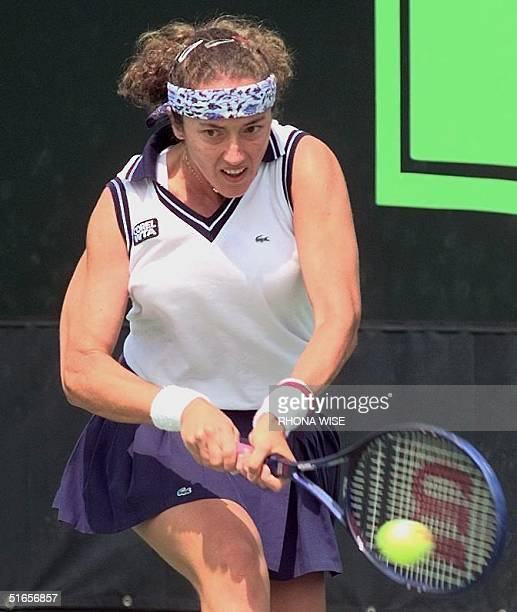 Number 13 seed Sandrine Testud of France returns a shot to Lori McNeil of the US 22 March in their third round match at The Lipton Championships in...
