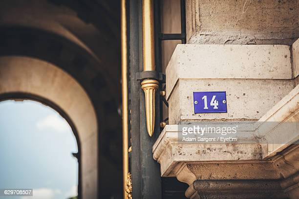 number 14 mounted on wall - number 14 stock photos and pictures