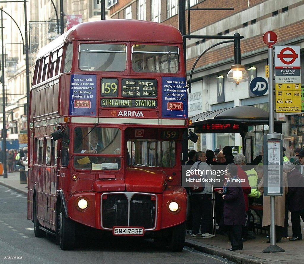 A number 159 Routemaster bus stops at Marble Arch on Oxford