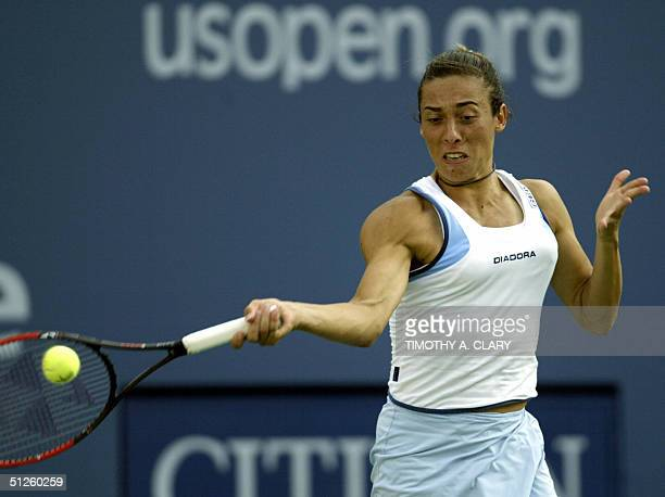 Number 16 seed Francesca Schiavone of Italy returns the ball to Angela Haynes of the United States during their match at the 2004 US Open in Flushing...