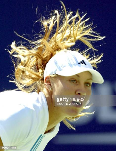 Number 17 seed Alicia Molik of Australia serves to Daniela Hantuchova during their 1st round match of the 2004 US Open at Arthur Ashe Stadium in...