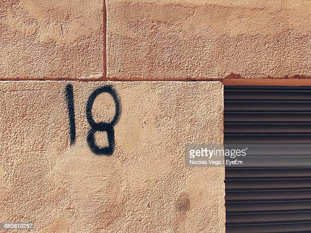 Number 18 On Peach Wall