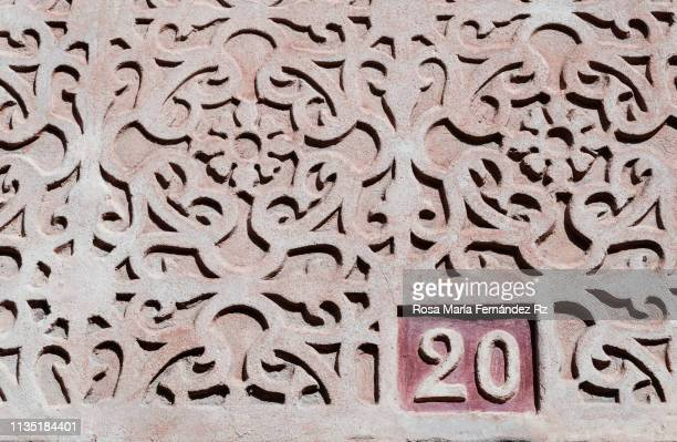 Number 20 (twenty) on characteristic facade decoration of a modern building folowing centuries-old patterns and tradition in Segovia, Castilla y Leon, Spain
