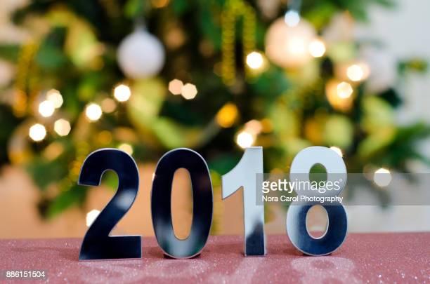 Number 2018 With Defocused Christmas Light Bokeh