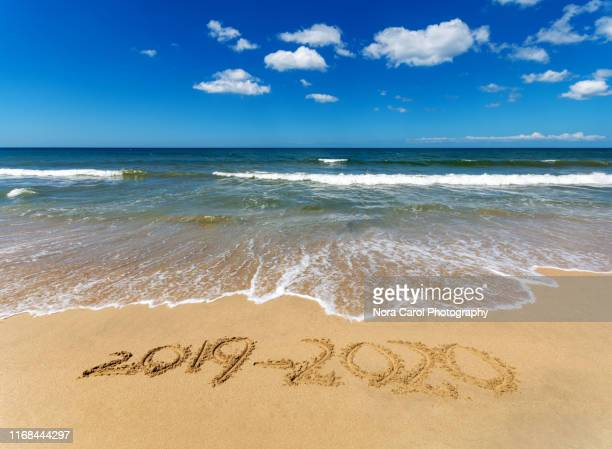 number 2019-2020 on a beach new year 2020 concept - 2020 calendar stock photos and pictures