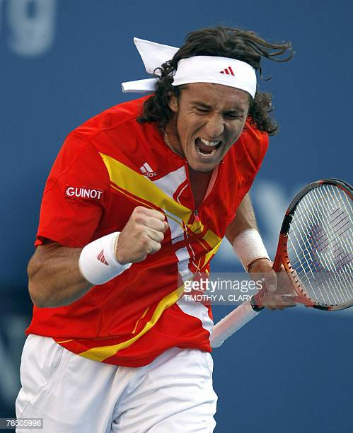 Number 23 seed Juan Monaco of Argentina pumps her fist during his fourth round match against third-seeded Serb Novak Djokovic at the US Open Tennis...