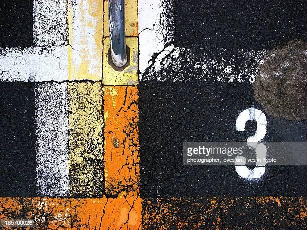 number 3 and the line on asphalt