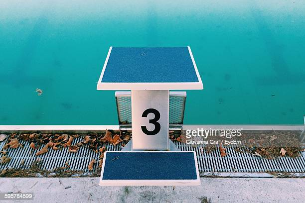 Number 3 Diving Board At Swimming Pool