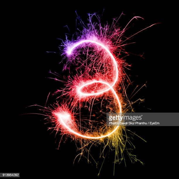 number 3 made by multi colored sparklers at night - number 3 stock pictures, royalty-free photos & images