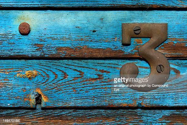 Number 3 on old wooden door