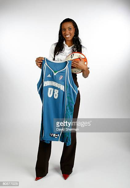 Number 3 overall pick by the Minnesota Lynx Candice Wiggins from Stanford poses for a portrait with a Lynx jersey during the 2008 WNBA Draft on April...