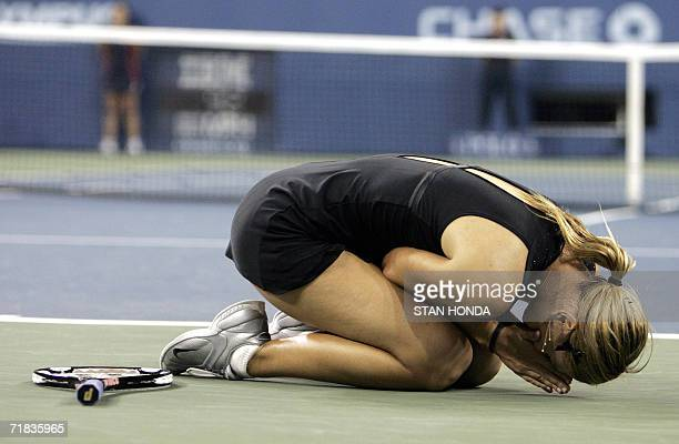 Number 3 seed Maria Sharapova of Russia falls to her knees as she celebrates defeating number 2 Justine HeninHardenne of Belgium 64 64 in the Women's...