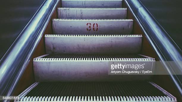 Number 30 On Steps Of Escalator In Building