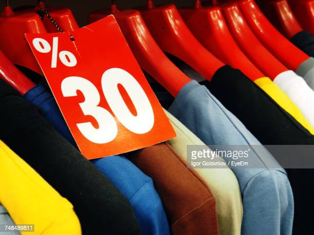 number 30 tag on clothes in store - sale stock photos and pictures