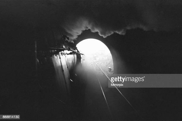 Number 34021 'Dartmoor' a Bulleid Pacific locomotive of the West Country Class seen here emerging from a tunnel during its final journey from...