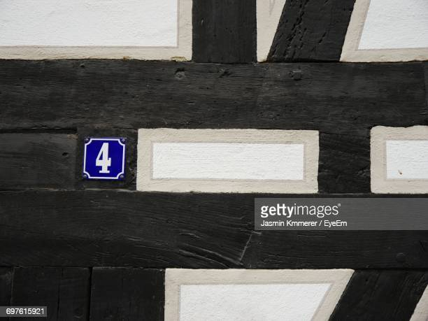 Number 4 And Pattern On Wooden Wall