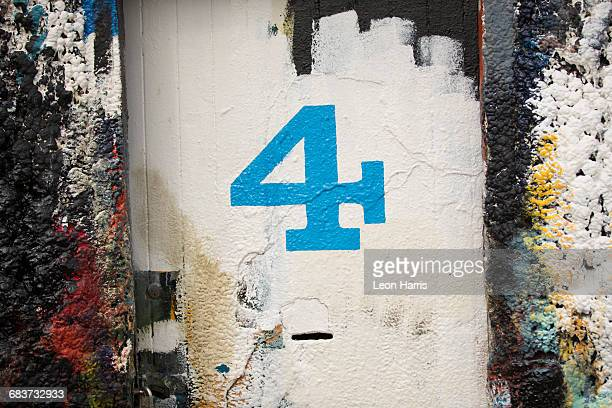Number 4 door and paint covered wall in ship painters yard