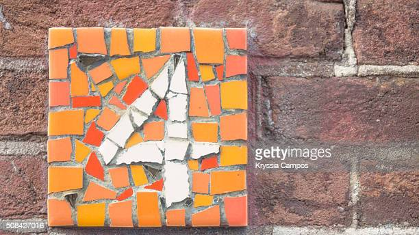 Number 4 in brick wall at Amsterdam city