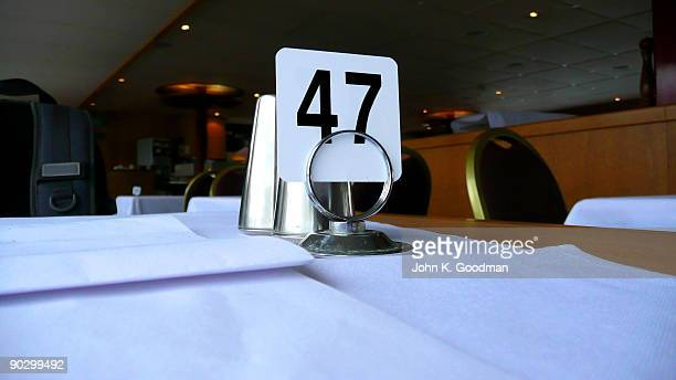 Number 47 sits on a restaurant table