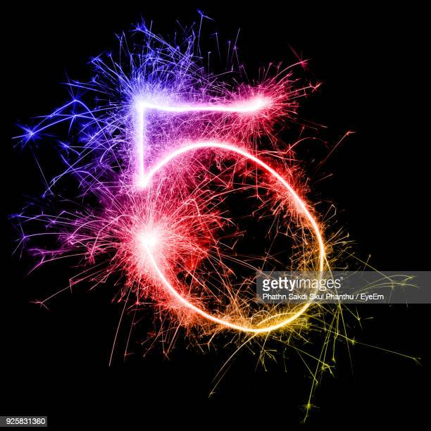 Number 5 Made By Multi Colored Sparklers At Night