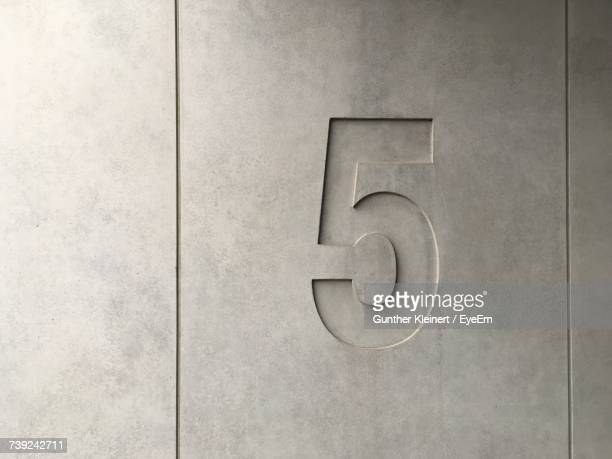 Number 5 On Concrete Wall