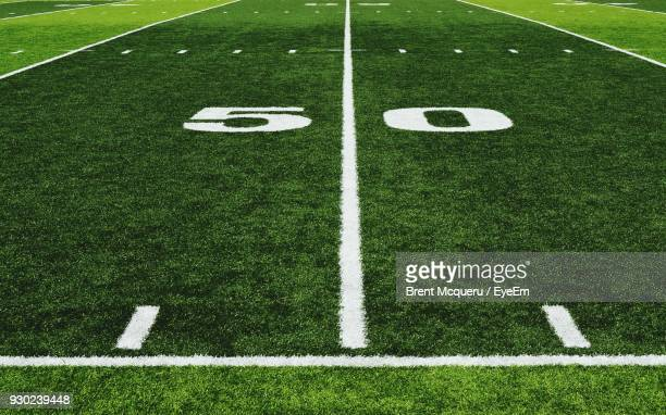 number 50 on american football field - football field stock pictures, royalty-free photos & images