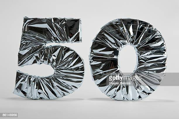 number 50 wrapped in silver foil - anniversary stock pictures, royalty-free photos & images